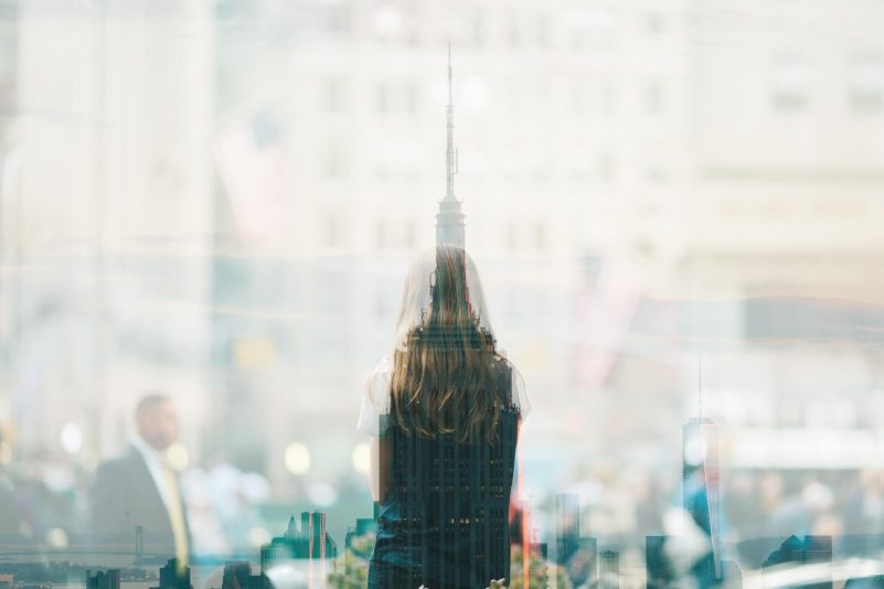 A Woman Stares Out A Window Reflecting On Work Life Balance Featured On Benu Creative Lifestyle Blog Series